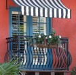 beautiful balcony with shutters awning