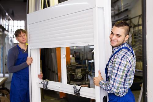 professionals installing an aluminium window shutter