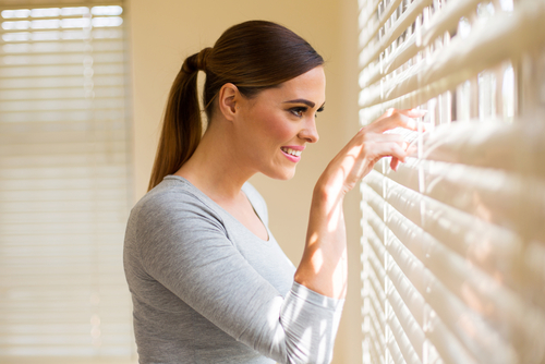 woman happy with her Blinds in Castle Hill