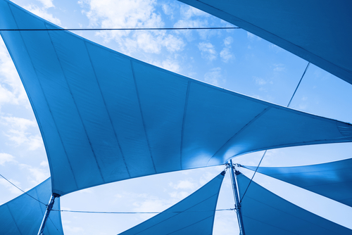 a set of blue Canopy Awnings set against a blue summer sky