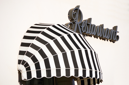 Image for awnings with logos for a restaurant by Shutters Australia