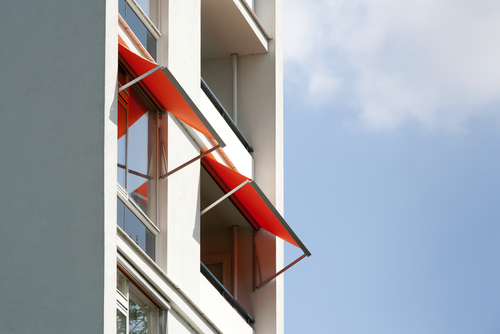 Image of retractable awnings on an apartment block by Shutters Australia