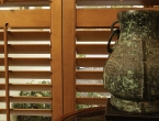 shutter-bifold-teak-close-up-with-chinese-urn