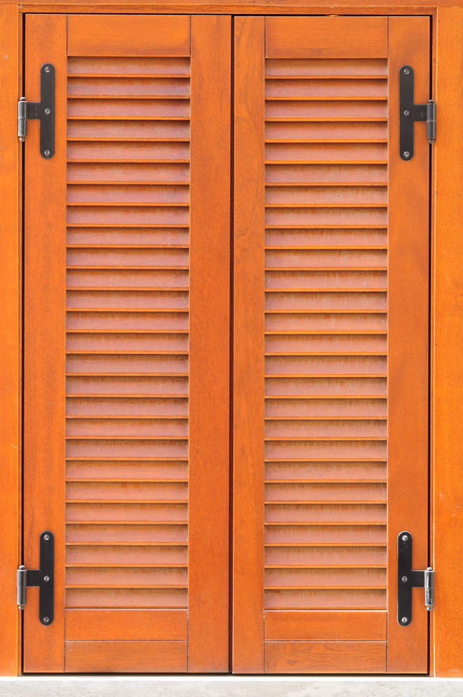Window of a house closed with wooden shutters
