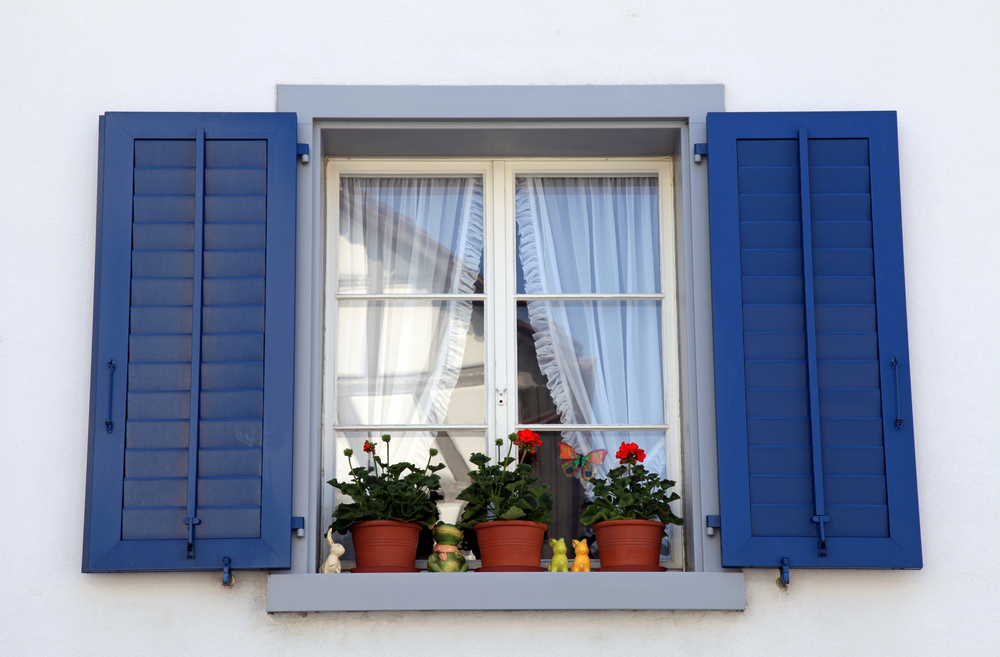 rustic window with blue shutters