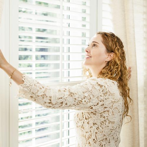 a woman adoring her australian shutters