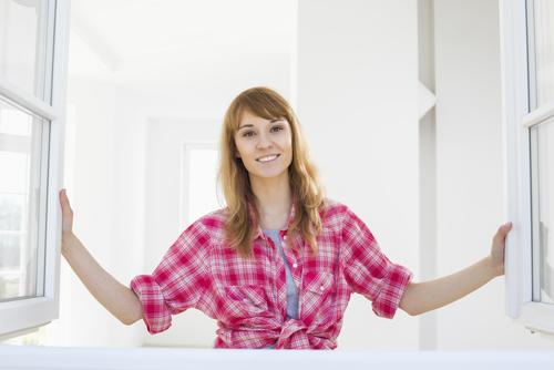 a woman doing DIY Shutters