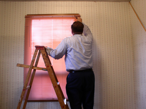 a man doing DIY Blinds in Sydney