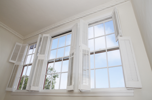 a picture of white open Window Shutters