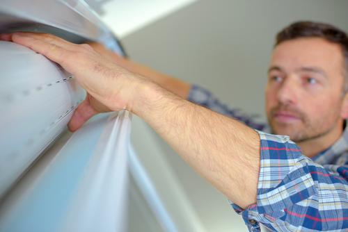 a man installing Roller Shutters in Sydney