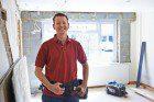 a man tackling DIY Plantation Shutters for his home
