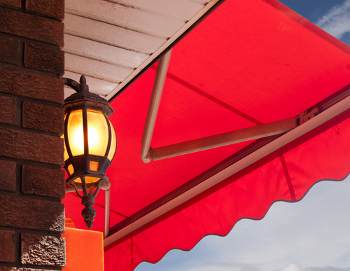a beautiful set of red Retractable Awnings