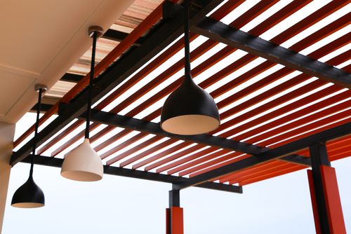 a picture of wooden awnings for homes used as a canopy of sorts by Shutters Australia