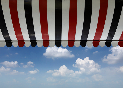 Image of a red white blue awning with vinyl fabric