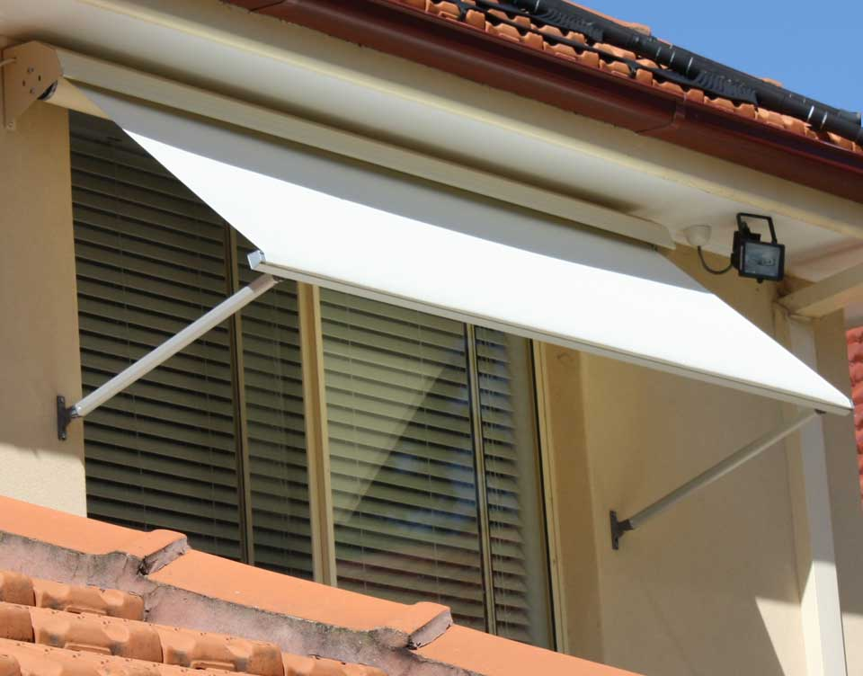 image of a compact motorised window awning